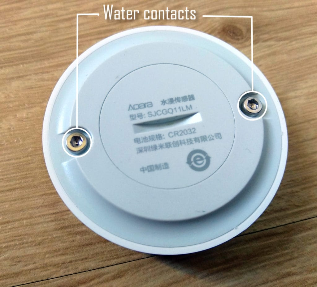 contacts on the bottom of the aqara water sensor. Used to warn me about water damages