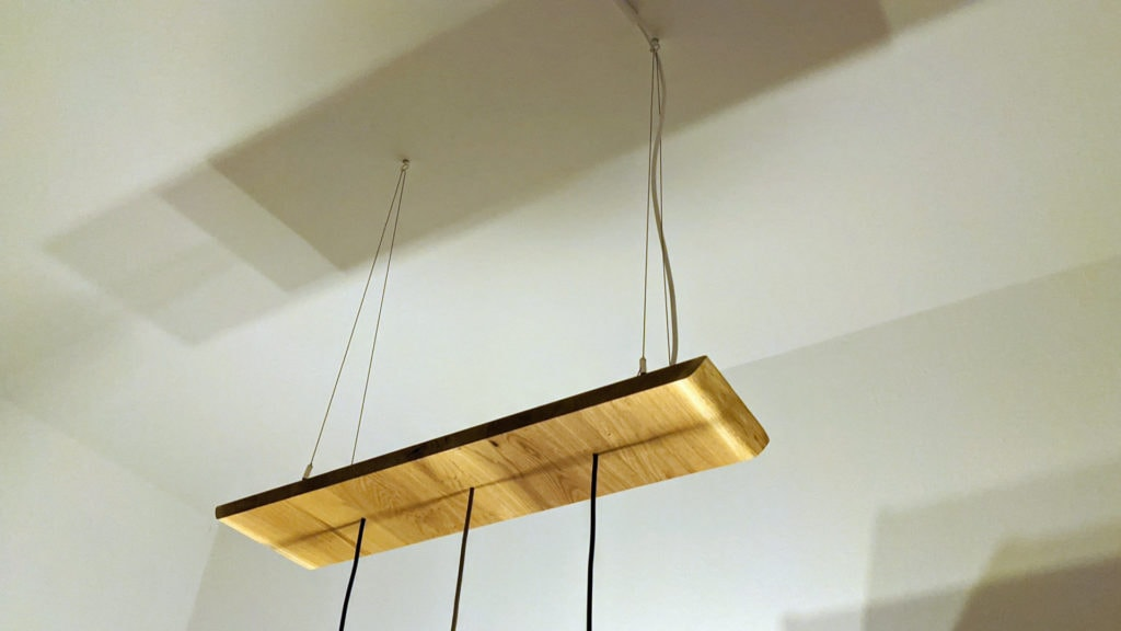 custom ceiling light secured via steel cables