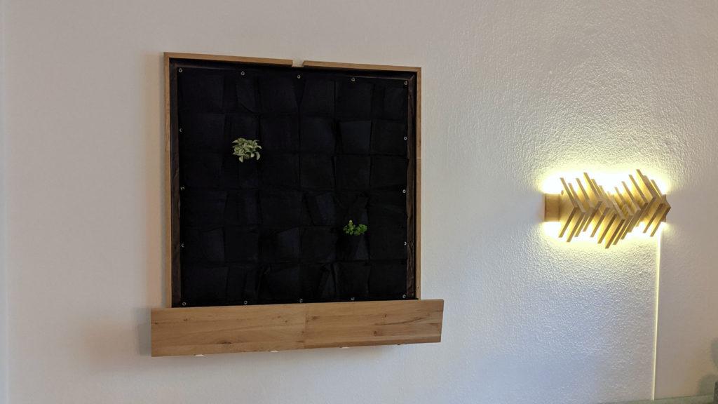 living wall frame beside my custom wall lamp