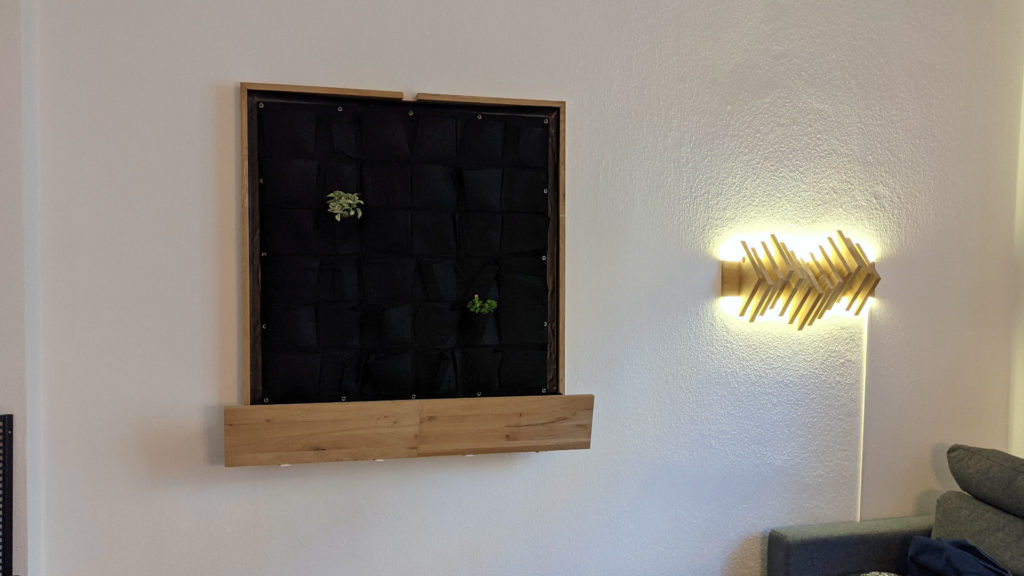 living wall mounted to the wall next to my waveform lamp